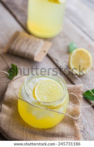 fresh lemonade on wooden background  - stock photo