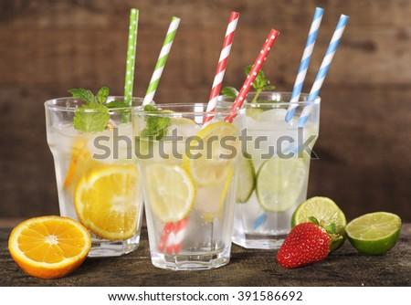 fresh lemonade with colorful straws - stock photo