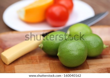 Fresh lemons with other salad vegetables