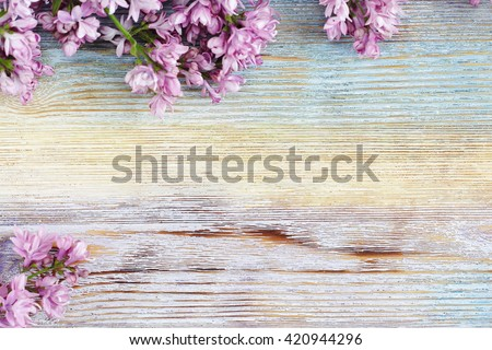 Fresh lilac flowers on the wooden vintage background. Selective focus. - stock photo