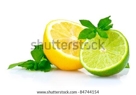 fresh lime, lemon and mint isolated on white - stock photo