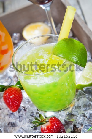 Fresh Lime pearl tea Cocktail standing on a bed of crushed ice - stock photo