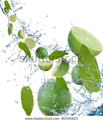 Fresh limes in motion - stock photo