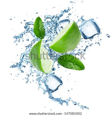 Fresh limes in water splash over white background - stock photo