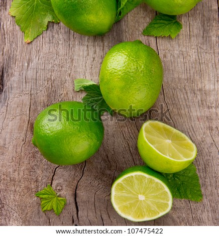 Fresh limes on wooden table, top view - stock photo