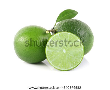 Fresh limes with green leaf. Isolated on white - stock photo