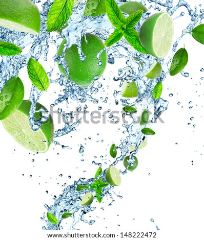 Fresh limes with water splashes on white background - stock photo