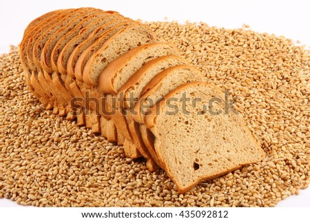 Fresh Loaves of wheat bread over wheat,Selective focus photograph. - stock photo
