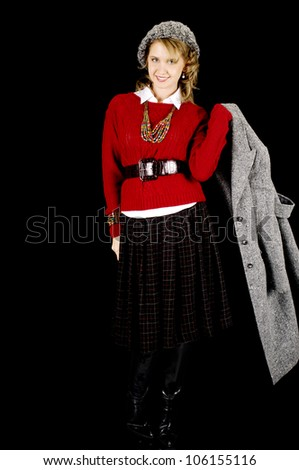 Fresh Looking Young Beauty Dressed for Winter.  Isolated on Black. - stock photo