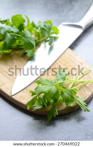 Fresh Lovage on a chopping board - stock photo