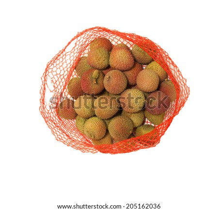 Fresh Lychees in a damaged net  - stock photo