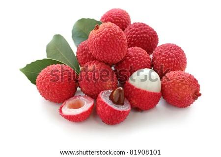 fresh lychees on white background - stock photo