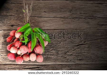 Fresh lychees on wooden background - stock photo