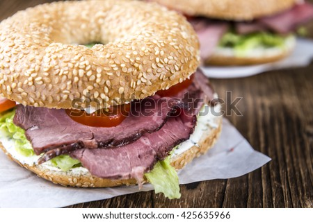 Fresh made Bagel with meadium grilled Roast Beef (selective focus) - stock photo
