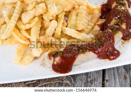 Fresh made German Currywurst (close-up shot) - stock photo