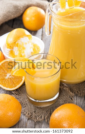 Fresh made Orange Juice on wooden background