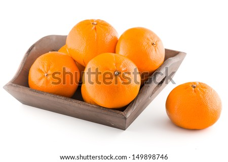 Fresh mandarins in a wooden basket on white background - stock photo