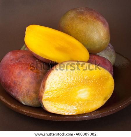 Fresh mango on ceramic plate - stock photo