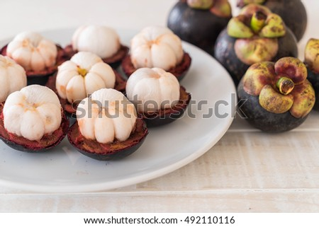 fresh mangosteen on wood table