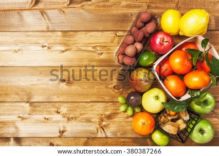 Fresh market fruits on wooden background. Healthy eating and dieting concept. Winter assortment. Copy space. Top view - stock photo