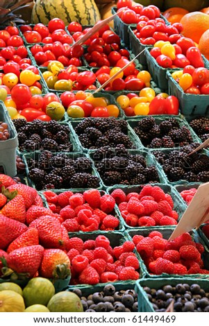 Fresh market produce at an outdoor farmer's market - stock photo