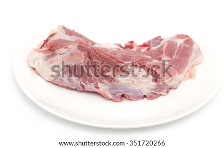 fresh meat in a dish on a white background - stock photo