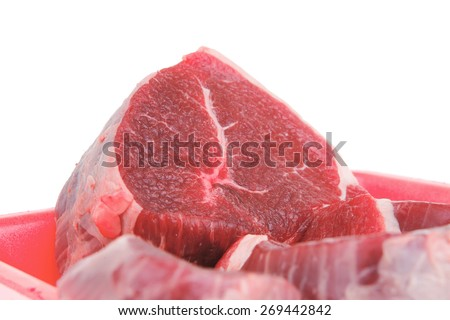 fresh meat : raw uncooked fat lamb pork fillet mignon loin on red tray isolated over white background - stock photo