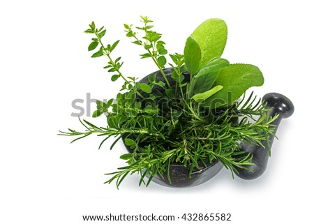 fresh mediterranean herbs, oregano, rosemary and sage in a mortar with pestle made of black granite isolated with shadows on a white background, copy space, selected focus, narrow depth of field