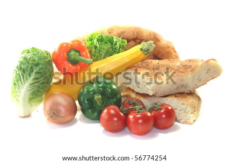 Fresh Mediterranean vegetables with pita bread on a white background