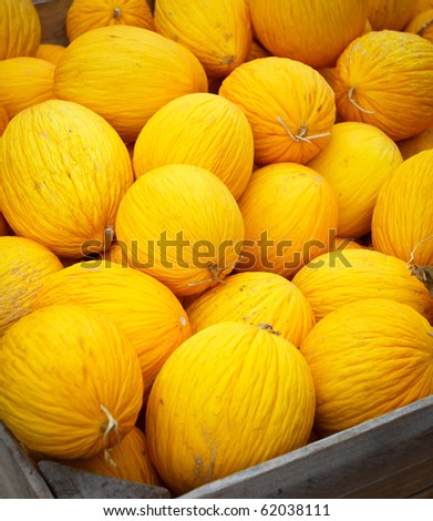 Fresh melon in a wooden box,shallow focus - stock photo