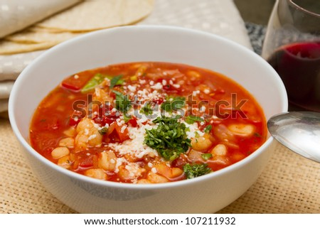 Fresh Mexican tomato soup with corn and vegetables