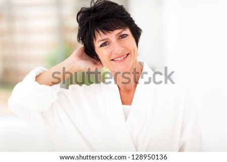 fresh middle aged woman in bathrobe