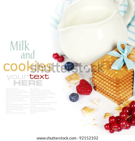 Fresh milk and biscuits with berries on white background (with sample text) - stock photo