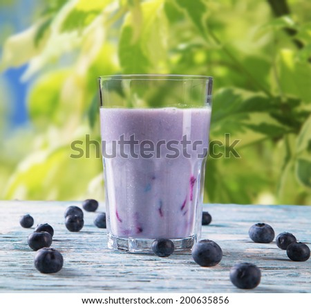 Fresh milk, blueberry drink on wooden table, assorted protein cocktails with fresh fruits. Natural background.  - stock photo