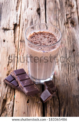 Fresh milk, chocolate drink on wodeen table, assorted protein cocktail. - stock photo