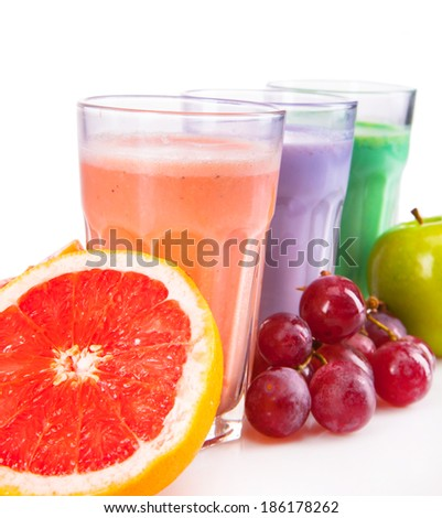Fresh milk, grapefruit, kiwi, apple and grape drinks isolated on white background, assorted protein cocktails with fruits. - stock photo