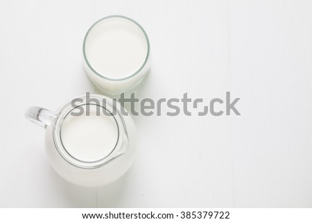 Fresh Milk in Glasses Bottle, Dairy Produce Concept of Breakfast on Wood Table Background, Country Rustic Still Life Style, Vintage Tone, Top view. Space for text. - stock photo
