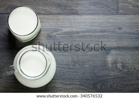 Fresh Milk on Glasses Bottle, Dairy Produce Concept of Breakfast on Wood Table Background, Country Rustic Still Life Style, Vintage Tone, Top view. Space for text. - stock photo