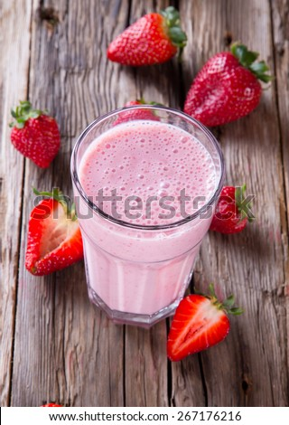 Fresh milk, strawberry drink on wooden table, assorted protein cocktail with fresh fruits.