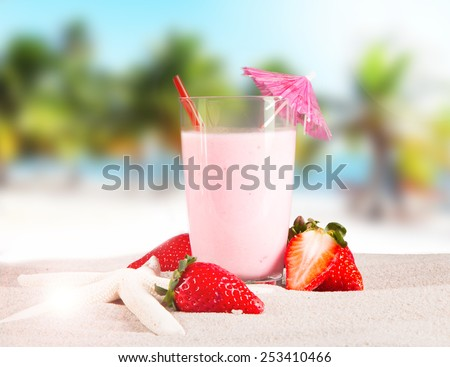 Fresh milk, strawberry drink on wooden table, assorted protein cocktails with fresh fruits and tropical beach background. - stock photo