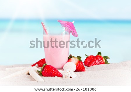 Fresh milk, strawberry on sand background, assorted protein cocktail with fruits. - stock photo