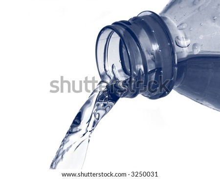 Fresh mineral water pouring from of a bottle - stock photo