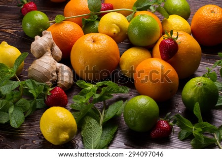 Fresh mint and citrus fruit. Various fruits scattered on a wooden base.