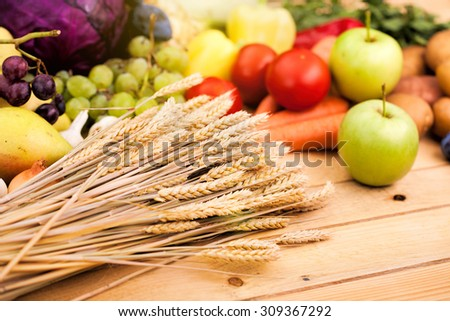 Fresh mix of vegetables and wheat on the wooden table  - stock photo
