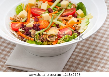 Fresh mixed colorful healthy salad closeup vegetarian food