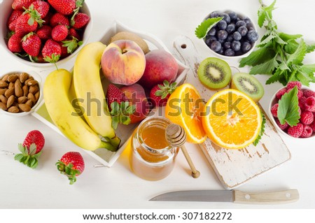 Fresh mixed fruits and berries. Healthy eating. Top view - stock photo