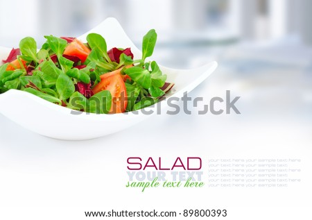 Fresh mixed salad with tomatoes - stock photo