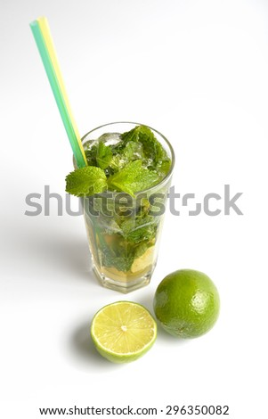 fresh mojito cocktail and lime green on a white background - stock photo