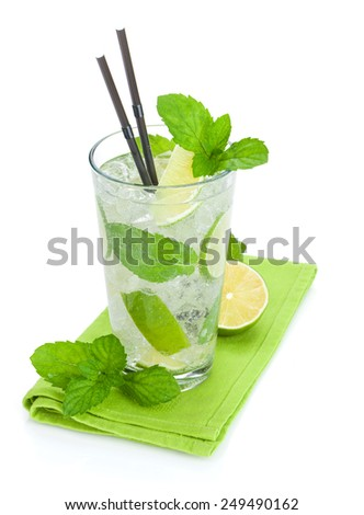 Fresh mojito cocktail and limes with mint. Isolated on white background - stock photo