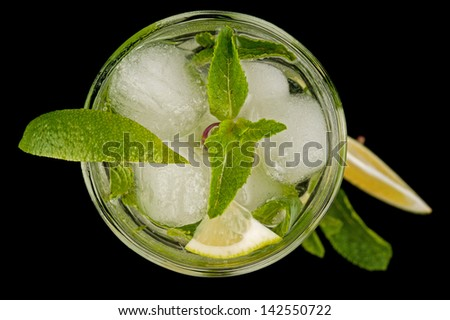 Fresh mojito cocktail top view on black - stock photo